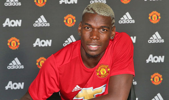 Above: Paul Pogba been unveiled as a Manchester United player | Photo: manutd.com