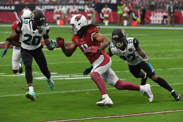 Jalen Ramsey #20 and Aaron Colvin #22 of the Jacksonville Jaguars close in on Larry Fitzgerald #11 of the Arizona Cardinals. |Source: Norm Hall/Getty Images North America|