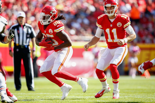 Jamaal Charles (25) of the Kansas City Chiefs runs the ball as Alex Smith (11) of the Kansas City Chiefs watches at Arrowhead Stadium during the game on October 11, 2015 in Kansas City, Missouri. (Oct. 10, 2015 - Source: Jamie Squire/Getty Images North America)