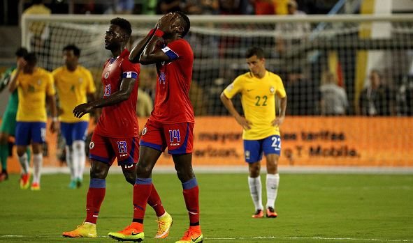 Haiti midfielder James Marcelin (in red, #14, right) celebrates after scoring a memorable goal against Brazil on Wednesday. Photo credit: Mike Ehrmann/Getty Images Sport