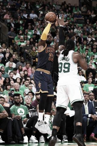 LeBron James shoots over Jae Crowder. Photo: Brian Babineau/NBAE/Getty Images