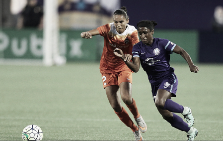 Jazmyne Spencer (right) scored twice in the Pride's first preseason match (Photo: Getty/Alex Menendez)
