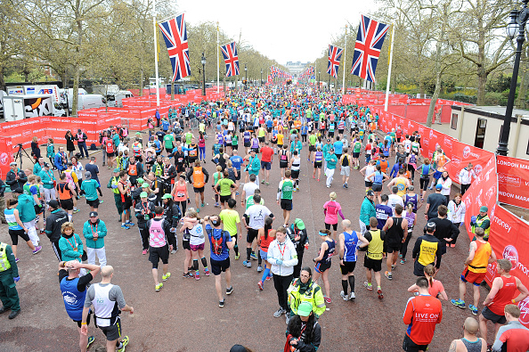 Runners walk down part of The Mall after completing the 26.2 miles race (Getty/Jeff Spicer)