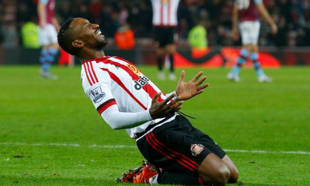 Defoe celebrating one of his two goals against Aston Villa.