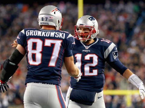 Tom Brady (12) has been without Rob Gronkowski for a while now, but the Patriots offense has been just fine (Jim Rogash/Getty Images)