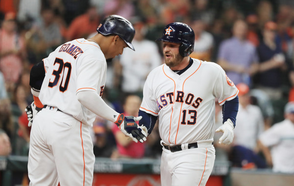 Tyler White #13 of the Houston Astros is greeted by teammate Carlos Gomez #30 after White hit a solo home run in the first inning of their game against the Detroit Tigers at Minute Maid Park on April 16, 2016 in Houston, Texas. (April 15, 2016 - Source: Scott Halleran/Getty Images North America)