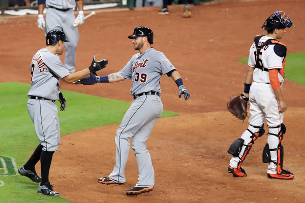 Nick Castellanos #9 of the Detroit Tigers (L) greets Jarrod Saltalamacchia #39 after Saltalamacchia hit a two-run home run in the sixth inning of their game against the Houston Astros at Minute Maid Park on April 16, 2016 in Houston, Texas. (April 15, 2016 - Source: Scott Halleran/Getty Images North America)
