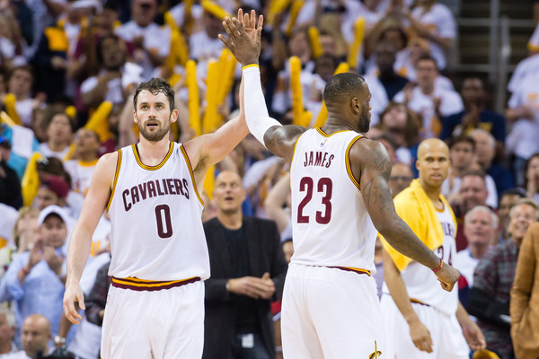 Kevin Love #0 and LeBron James #23 of the Cleveland Cavaliers celebrate during the second quarter of the NBA Eastern Conference Quarterfinals against the Detroit Pistons at Quicken Loans Arena on April 17, 2016 in Cleveland, Ohio. The Cavaliers defeated the Pistons 106-101. NOTE TO USER: User expressly acknowledges and agrees that, by downloading and or using this photograph, User is consenting to the terms and conditions of the Getty Images License Agreement. (April 16, 2016 - Source: Jason Miller/Getty Images North America)