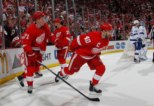 Henrik Zetterberg #40 of the Detroit Red Wings celebrates his second period goal with Dylan Larkin #71 while playing the Tampa Bay Lightning in Game Three of the Eastern Conference Quarterfinals during the 2016 NHL Stanley Cup Playoffs at Joe Louis Arena on April 17, 2016 in Detroit, Michigan. (April 16, 2016 - Source: Gregory Shamus/Getty Images North America)