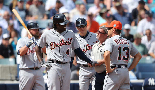 TAMPA FL- MARCH 2: Detroit Tigers outfielder Cameron Maybin #4 gets hit in the hand with a pitch and is looked after by trainer Kevin Rand during the first inning of the Spring Training game against the New York Yankees at George Steinbrenner Field in Tampa, Florida. (March 1, 2016 - Source: Leon Halip/Getty Images North America)