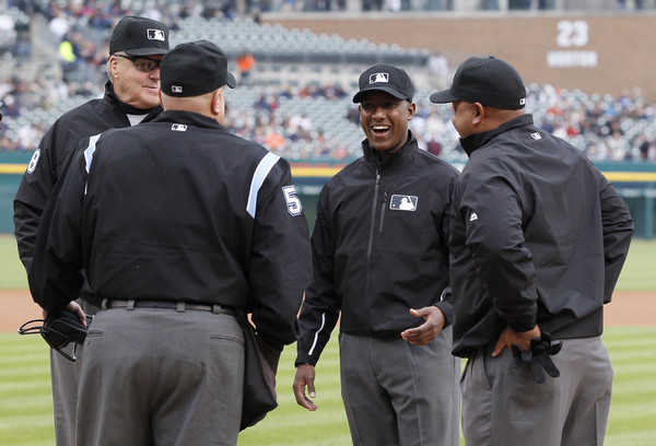 Second base umpire Ramon De Jesus, second from right, laughs with the umpire crew before a game between the Detroit Tigers and Cleveland Indians at Comerica Park on April 22, 2016 in Detroit, Michigan. (April 21, 2016 - Source: Duane Burleson/Getty Images North America)