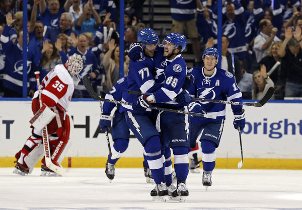 Nikita Kucherov #86 of the Tampa Bay Lightning celebrates his goal with teammate Victor Hedman #77 as goalie Jimmy Howard #35 of the Detroit Red Wings reacts during the first period in Game Two of the Eastern Conference Quarterfinals during the 2016 NHL Stanley Cup Playoffs at Amalie Arena on April 15, 2016 in Tampa, Florida. (April 14, 2016 - Source: Mike Carlson/Getty Images North America)