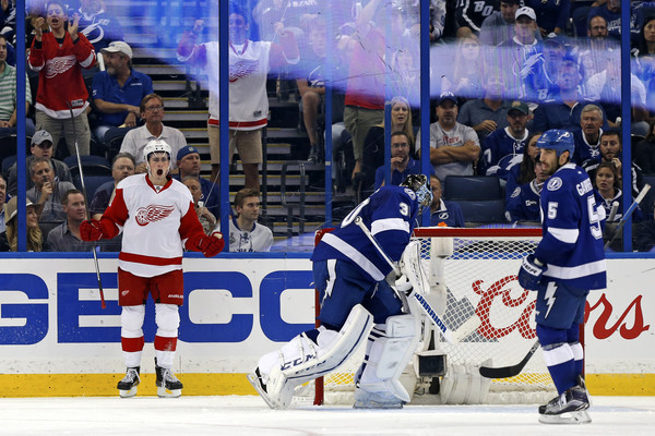 Dylan Larkin #71 of the Detroit Red Wings celebrates his goal as goalie Ben Bishop #30 and Jason Garrison #5 of the Tampa Bay Lightning react during the second period in Game Two of the Eastern Conference Quarterfinals during the 2016 NHL Stanley Cup Playoffs at Amalie Arena on April 15, 2016 in Tampa, Florida. (April 14, 2016 - Source: Mike Carlson/Getty Images North America)