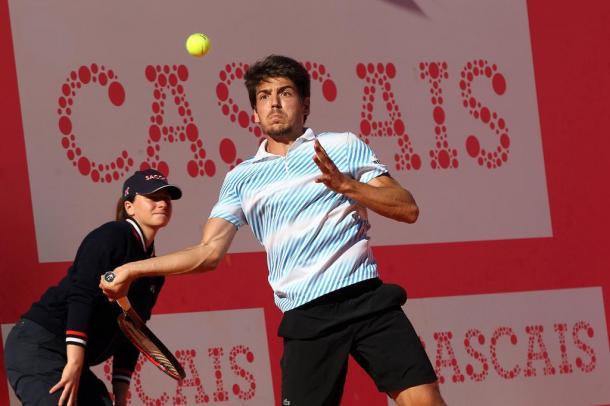 João Domingues hits a forehand during his match against Alex de Minaur. (Photo by Millennium Estoril Open)