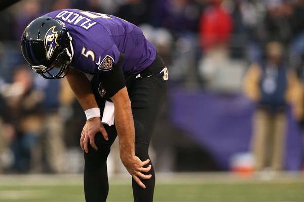 Ravens quarterback Joe Flacco (#5) grabs his knee in pain in the final drive against the Rams. It was later found out he tore his ACL -- Patrick Smith/Getty Images