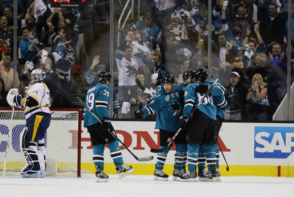 Joe Pavelski #8 of the San Jose Sharks is congratulated by teammates after he scored a goal on Pekka Rinne #35 of the Nashville Predators in the first period of Game Seven of the Western Conference Second Round during the 2016 NHL Stanley Cup Playoffs at SAP Center on May 12, 2016 in San Jose, California. (May 11, 2016 - Source: Ezra Shaw/Getty Images North America)