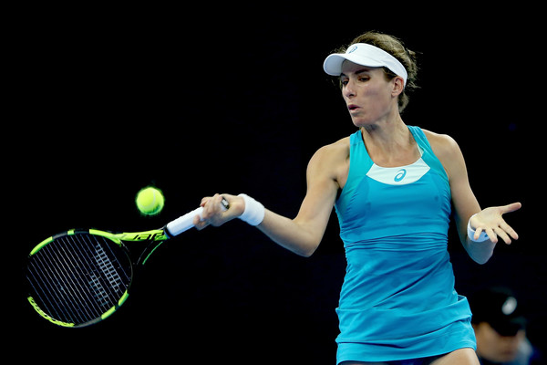 Konta battles back to beat Keys
