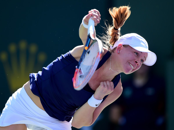 Johanna Larsson hits a serve | Photo: Harry How/Getty Images North America