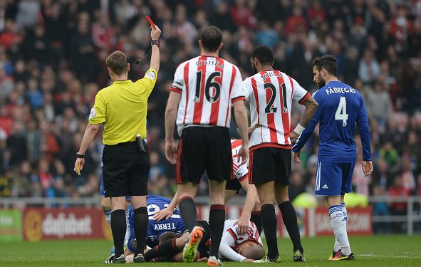 John Terry (left, on ground) of Chelsea is shown a red card by referee Mike Jones after fouling Wahbi Khazri of Sunderland | Gareth Copley - Getty Images