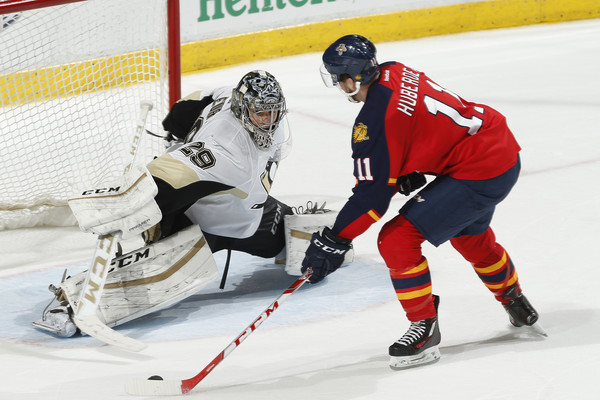Goaltender Marc-Andre Fleury #29 of the Pittsburgh Penguins stops a shot by Jonathan Huberdeau #11 of the Florida Panthers at the BB&T Center on February 15, 2016 in Sunrise, Florida. The Panthers defeated the Penguins 2-1 in a shoot out. (Feb. 14, 2016 - Source: Joel Auerbach/Getty Images North America)