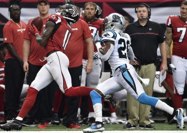 Julio Jones making one of his 12 catches against the Carolina Panthers | Source: Rainier Ehrhardt - AP Photo