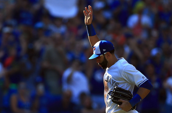 José Bautista waves to the crowd after being pulled from what will most likely be his last game at Rogers Centre in a Blue Jays uniform in the ninth inning. | Photo: Vaughn Ridley/Getty Images