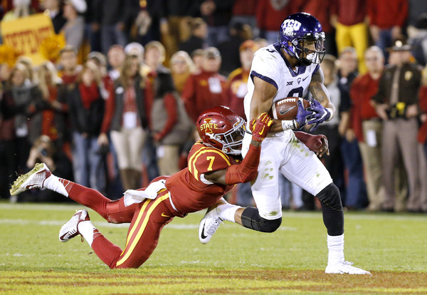 AMES, IA â OCTOBER 17: Wide receiver Josh Doctson #9 of the TCU Horned Frogs is sacked by defensive back Qujuan Floyd #7 of the Iowa State Cyclones as he rushed for yards in the first half of play at Jack Trice Stadium on October 17, 2015 in Ames, Iowa. (Oct. 16, 2015 - Source: David Purdy/Getty Images North America)