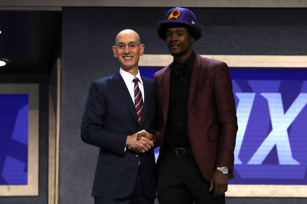 Josh Jackson walks on stage with NBA commissioner Adam Silver after being drafted fourth overall by the Phoenix Suns. |Source: Mike Stobe/Getty Images North America|