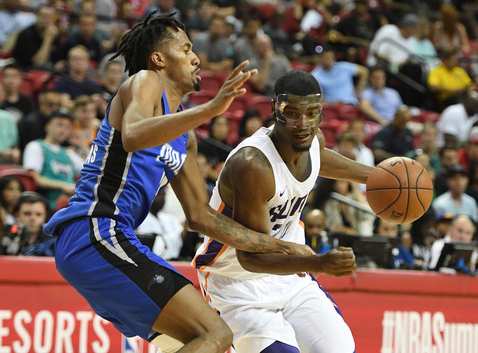 Josh Jackson #20 of the Phoenix Suns drives against Braian Angola-Rodas #19 of the Orlando Magic during the 2018 NBA Summer League. |Ethan Miller/Getty Images North America|