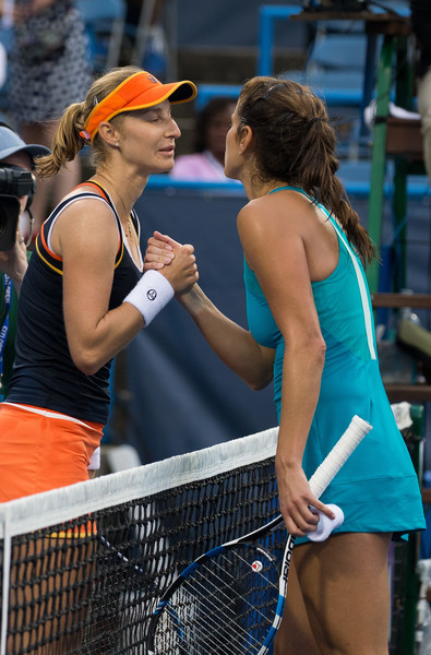 Both players share a warm embrace at the net | Photo: Tasos Katopodis/Getty Images North America