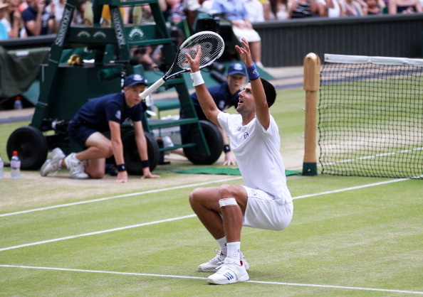 Djokovic broke through on the grass in 2011, claiming his first Wimbledon title. Credit: Julian Finney/Getty Images