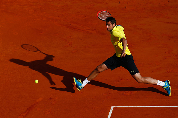 Cilic runs down a forehand at the 2015 Monte Carlo Rolex Masters against Florian Mayer of Germany. Credit: Julian Finney/Getty Images