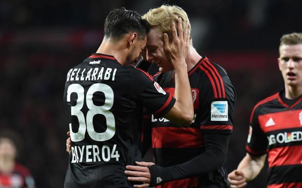 Bellarabi and Brandt embrace. | Image source: Comunio