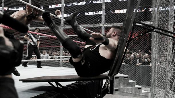 KO was sent crashing through two tables. Photo- WWE.com