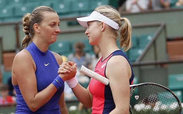 Kvitova and Julia Boserup (right) embrace each other at the net after the conclusion of their match at the French Open. Photo credit: Tennis.life.