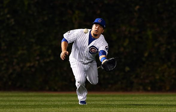 Kyle Schwarber #12 of the Chicago Cubs misses a catch hit by Wilmer Flores #4 of the New York Mets in the first inning during game four of the 2015 MLB National League Championship Series at Wrigley Field on October 21, 2015 in Chicago, Illinois. (Photo by Elsa/Getty Images
