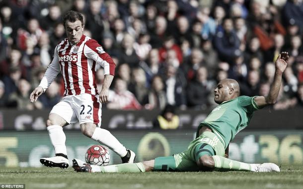 Above: Younes Kaboul slides in on Xherdan Shaqiri in Sunderland's 1-1 draw with Stoke City | Photo: Reuters