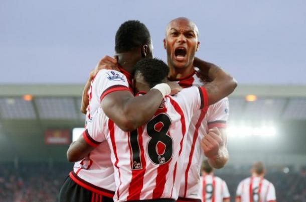 Younes Kaboul and Lamine Kone cuddle into top scorer Jermain Defoe. (UK Reuteurs)