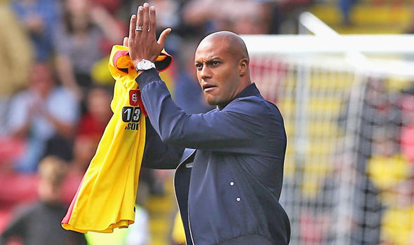 Watford's back three, including new signing Younes Kaboul, struggled against Arsenal's clever movement | picture: Watford FC