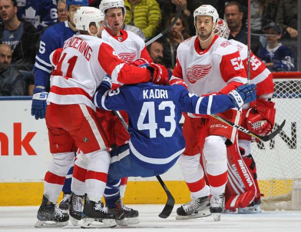 Nazem Kadri (in blue) is sent to the ice in front of the Red Wings net. Photo: Claus Andersen/NHLI via Getty Images