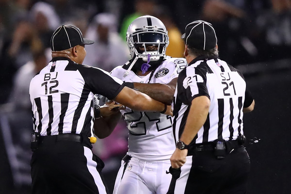 Marshawn Lynch #24 of the Oakland Raiders is restrained after coming off the bench and shoving a referee during a scrum with the Kansas City Chiefs. Lynch was ejected for unsportsmanlike conduct. |Source: Ezra Shaw/Getty Images North America|