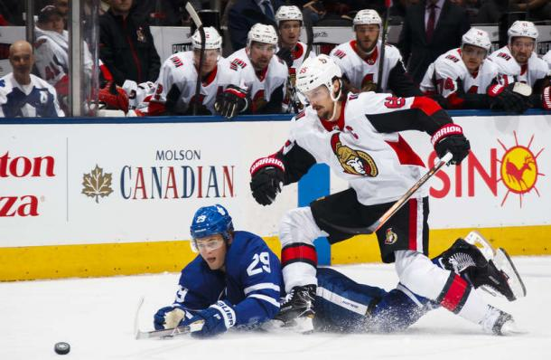 Erik Karlsson losses a puck battle to a sprawling William Nylander. Photo: Mark Blinch/Getty Images