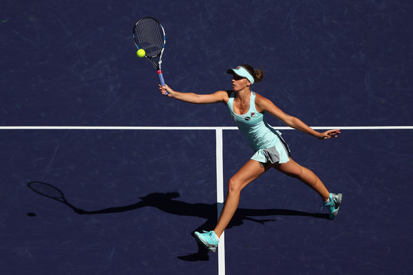Karolina Pliskova of Czech Republic hits a forehand volley against Daria Kasatkina of Russia during day eleven of the 2016 BNP Paribas Open. | Photo: Julian Finney/Getty Images North America