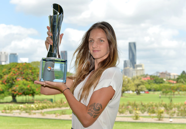 Karolina Pliskova posing alongside her Brisbane International trophy   Photo: Bradley Kanaris/Getty Images AsiaPac