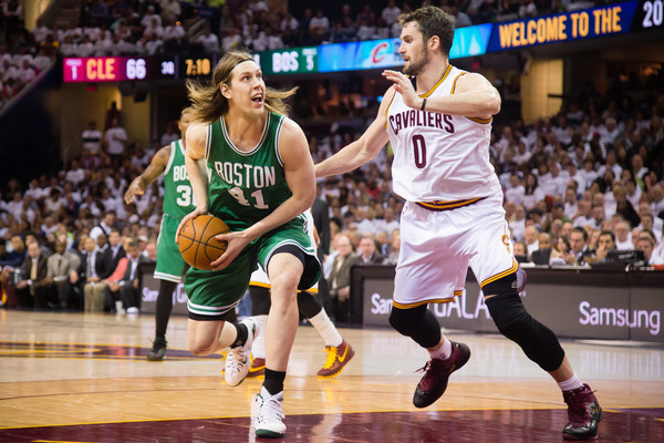 Kelly Olynyk #41 of the Boston Celtics drives around Kevin Love #0 of the Cleveland Cavaliers  (April 20, 2015 - Source: Jason Miller/Getty Images North America)