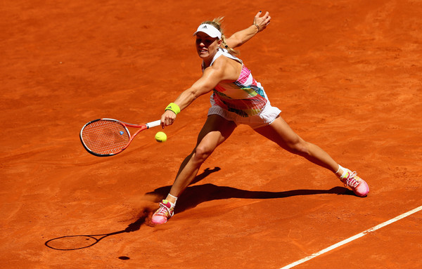 Angelique Kerber slides during her first round loss in Madrid. Photo: Clive Brunskill/Getty Images
