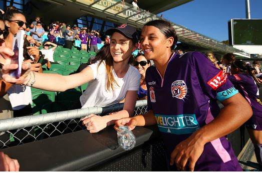 Sam Kerr takes a photo with a fan after a game against Sydney FC | Source: Paul Kane - Getty Images