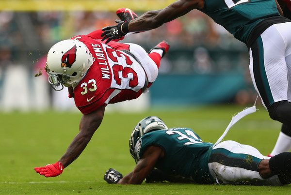 Cardinals running back Kerwynn Williams #33 is tackled by Jalen Mills #31 of the Philadelphia Eagles. |Oct. 7, 2017 - Source: Mitchell Leff/Getty Images North America|