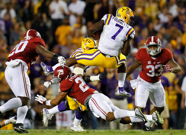 Leonard Fournette of LSU rushes the ball against the Alabama Crimson Tide. Photo Credit: Kevin C. Cox of Getty Images