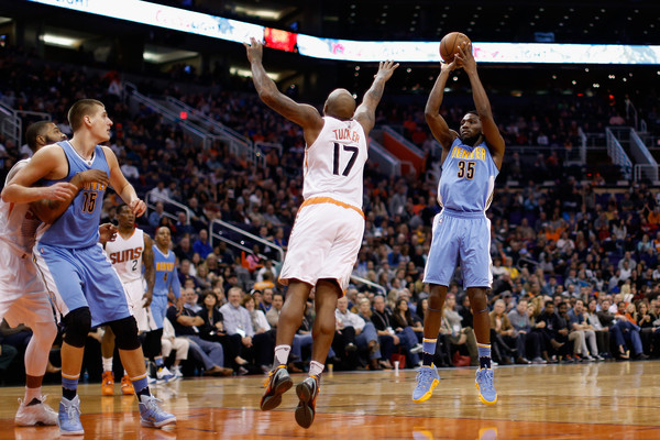 Faried takes a shot against the Suns. Christian Petersen/Getty Images North America